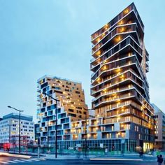 Paris'+tallest+housing+block+in+over+40+years+is+clad+with+gold+and+silver+metal