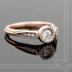 Diamond Halo Ring in 14k rose gold