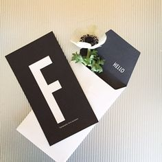 F for Far or Father. A personal greeting card in simple black and white design.