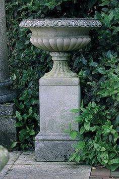 Regency Urn Traditional Stone Planter on garden site