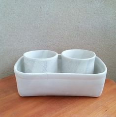 Pair of snowy matte white cups in a matching container. Handbuilt using soft slab technique. Mary Pulliam, 11/2016.