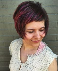 Pink color and short hair. Really short bangs swept to the side.