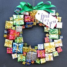 We all know that the fun part of Christmas is tied up with ribbons and bows. So what better way to greet visitors than with a DIY gift-box wreath? To make, purchase an assortment of foil gift-box ornaments and snip off the ornamental string. Hot-glue the boxes one by one to a wire wreath form until the gaps are filled. Finish with a large green bow and gift tag.