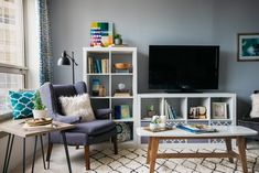 Blue living room, Ikea storage fun and comfy -Before & After: A Chicago Student&. - Ikea DIY - The best IKEA hacks all in one place Small Space Living Room, Ikea Living Room, Small Apartment Living, Living Room Shelves, Small Room Design, Living Room Grey, Small Spaces, Small Living, Living Rooms