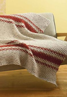 Free Knitting Pattern for Cozy Nook Throw - A woven stitch with just a four row four stitch repeat gives a diagonal texture to this blanket knit in super bulky yarn.