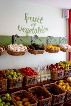 Nice tidy basket displays for produce and black hand written signage. Spring Hill Deli | Brisbane