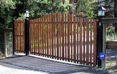Difranco Gate & Fence Company is a residential and commercial custom automated driveway gate contractor providing quality new gate construction services as well as restoration, alterations, repairs, and replacement gate services in - Single Arched Automatic Gate - Black Steel Frame & Redwood Picket - Forestville CA