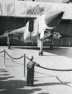 A little boy watches the Canadian-built fighter, the Avro Arrow, as it is wheeled out of its hangar in 1958 or Military Jets, Military Aircraft, Avro Arrow, Canadian History, American History, Air Festival, Vintage Airplanes, Air Show, Fighter Jets