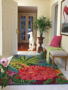 love the colorful entryway  the flamingo print on the wall...would also look great as a guest room or bathroom