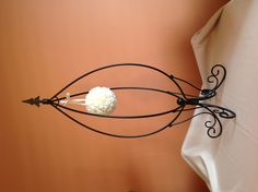 Black wrought iron stand w/ kissing ball