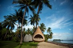 The new Dedon Island resort on Siargao, Phillipines, is close to one of the world's best surf breaks, Cloud 9 (Kelly Slater is a fan), and has an outdoor cinema along with spa and paddle board classes.:)