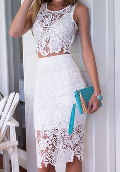 What's New: This two piece dress features a body-hugging fit with a lace crochet shell. It has a back zipper closure, an elastic waistline and a slit for a flirty look. Dress to impress by pairing this white dress with a pair of pumps and a stylish clutch.