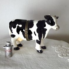 Cow Box, Black and White Cow, Porcelain Box, Fake Limoges Box,  Trinket Box, Treasure Box, Hinged Box, Jewelry Box, Farm Animal, Milkcan  $17.99 -- I have very similar but more finely made cow which came with a cardboard carton, not a can, made by PHB, very cute!