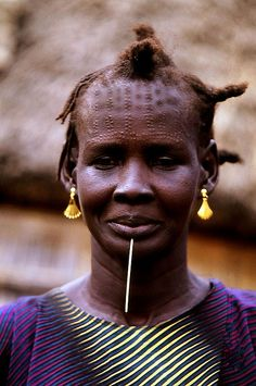 Africa | Portrait of a Nuer woman taken in the Gambela region of Ethiopia on the border with Sudan | © Boaz Images