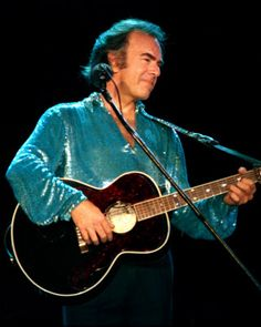 Neil Diamond.  If you are feelin bad, put on some Neil Diamond and you'll snap out of it.  Just like that.