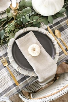 neutral low-key Thanksgiving tablescape that is simple and inexpensive to recreate using plaid fabric, white pumpkins, eucalyptus, and brass. Hosting Thanksgiving, Thanksgiving Table Settings, Thanksgiving Tablescapes, Thanksgiving Crafts, Holiday Tablescape, Holiday Dinner, Holiday Decor, Holiday Ideas, Low Key