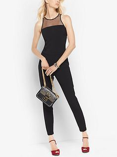 A mesh bodice punctuates this jumpsuit with undeniable allure. Designed for a slim fit in a scuba-like fabric with an exposed back zipper, it's a modern alternative to the LBD.