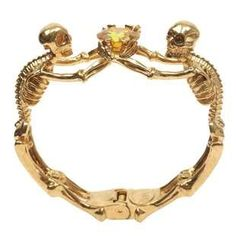 This Alexander McQueen Bracelet Contains Topaz and a Skeleton Design #halloween trendhunter.com