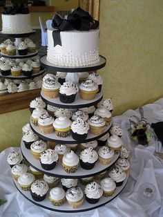 Cupcake Wedding Cakes, I sorta like this but then again I think its sorta not as fancy. Eh. It's cute
