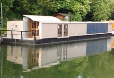 6.28.12 - Bauhaus Boat/Barge/Houseboat for Sale and Completely Solar Powered - cleantechnica.com. Fully solar powered DIY houseboat. Video included.
