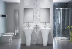 The centrepiece of this bathroom is our immaculate Pure one-piece basin that mimics the graceful shape of a flowering stem.