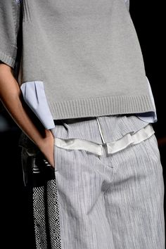 Grey sweater & trousers with contrasting fabric panels & micro patterns; fashion details // Sacai