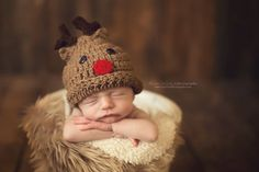 Newborn photography with a Santa hat for being a Christmas baby :)