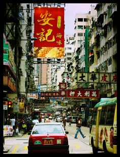 The ever bustling streets of Kowloon, Hong Kong. Either you love it (food & shopping) or hate it (crowds)