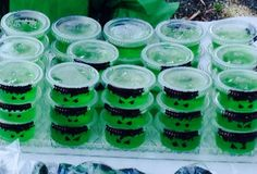 Hulk jello cups---Image Only---Looks like condiment containers with green Jell-O and Hulk face drawn on with Sharpie