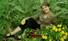 Alice Waters reclines with lemons.