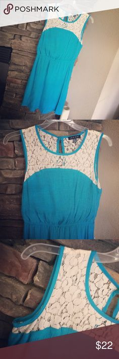 Turquoise and Lace Dress Pretty turquoise dress with lace detail. Open slit on upper back looks nice with a lace bralette underneath. It has a cinched waist and is fully lined underneath. It has small string loops at the waistline so it could be worn with a skinny belt. Length from top of shoulder is approximately 34 inches. It is in great condition. As U Wish Dresses