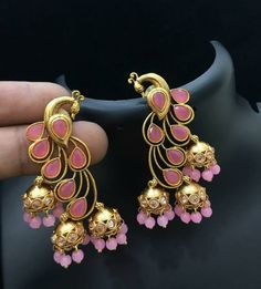 Beautiful dancing peacock design triple jumkhis with pink color stones. 09 Augus… Beautiful dancing peacock design triple jumkhis with pink color stones. India Jewelry, Ear Jewelry, Trendy Jewelry, Gold Jewelry, Fashion Jewelry, Peacock Earrings, Indian Earrings, Diamond Earrings, Gold Pendent