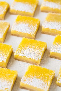Lemon Bars - this is my favorite lemon bar recipe! These just melt away in your mouth and are bursting with fresh lemon flavor.