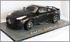 This was the biggest car cake i have ever made. It was even seen and commented on by Top Gear Presenters James May and Jeremy Clarkson! It fe well over 200 people with loads still left over it took two of us to carry it into the venue! i was a whopping 35 inches long!  the board was even longer!!