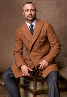 Isaia coat.  Source: The Big Black Book's Essentials for Fall 2012    That's the jacket.      Yes