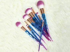 Pre-order: estimated ship date is Feb 8, 2017! Beautiful makeup brushes to enchant your inner unicorn!  Features rainbow horn handles and super soft multi-color bristles. Completed with a gold settin