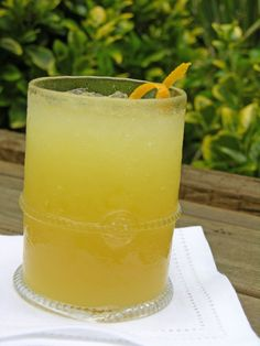 GOOMBAY SMASH     1 oz spiced rum    1 oz. Malibu coconut rum    ¼ oz apricot brandy    2 oz. pineapple juice    2 oz. orange juice    Mix all of the ingredients in a shaker with ice until frothy. Pour over ice and garnish with an orange. My own version substitutes an equal part of Grand Marnier for the brandy.
