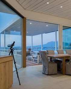 Dining room and balcony with a view of the Helderberg over False Bay. #gordonsbay #architecture #architect Balcony, Dining Room, Architecture, Outdoor Decor, Projects, Home Decor, Arquitetura, Log Projects, Blue Prints