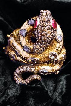http://rubies.work/0065-ruby-rings/ Codognato ruby-eyed snake bracelet - HarpersBAZAAR.com