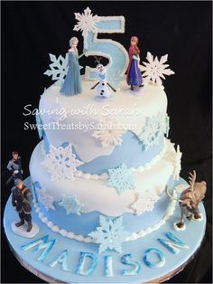 Frozen Cake with Elsa, Anna, Olaf, Kristoff, Sven, Hans  Frozen cake covered in snowflakes