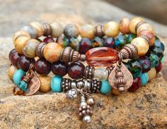Free your spirit with this Stacked boho bracelet set of 3. Top Bracelet is a boho style artisan bracelet made with 8mm Crazy Lace Agate with a Sienna Czech focal bead and Copper Red Charms and Finding