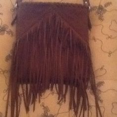 Faux suede fringe cross body Faux  suede caramel brown fringe cross body. Super cute and sassy.. Great condition, from a smoke free home.  Express Bags Crossbody Bags