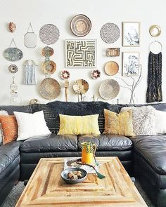 Stunning eclectic home in Edmonton #pillows #jujuhat #kubacloth #cowhide #decorativepillows #africanmasks #livingroom #interiordesign