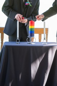 Rainbow candle lighting wedding ceremony | Ohio Rainbow-Themed Gay Wedding | Equally Wed - LGBTQ Weddings