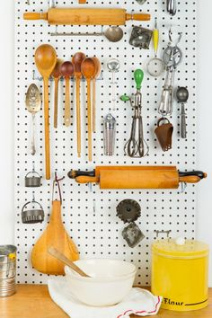 Create a Kitchen Hangout  Short on cabinet space? Attach a painted pegboard (available at hardware stores) to the wall, then loop in metal hooks for a display that'll keep your most-used tools neatly in one place.
