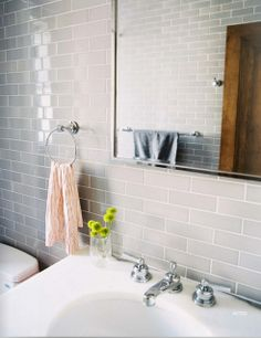 Minimalist Bathroom Photo - Gray subway tile and a striped hand towel in a bathroom Bathroom Renos, Laundry In Bathroom, Grey Bathrooms, Beautiful Bathrooms, Modern Bathroom, Bathroom Gray, Travertine Bathroom, Tile Grout, Downstairs Bathroom