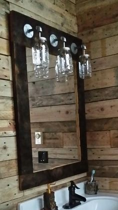 Galvanized Pipe & Mason Jars. Bathroom mirror/light fixture combo.