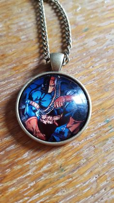 Deathstroke Necklace by AwesomeOddities on Etsy