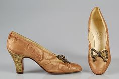 Evening pumps André Perugia  Date: ca. 1926 Culture: French Medium: Silk, metal Accession Number: 2009.300.4806a, b