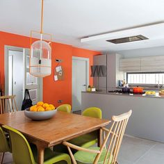 Orange kitchen decorating with bright colours to revitalise your home decor and grey kitchens colour appliances . Orange Dining Room, Orange Kitchen Decor, Living Room Orange, Kitchen Colors, Orange Kitchen Walls, Kitchen Ideas, Orange Walls, Kitchen Feature Wall, Gray Bathroom Decor